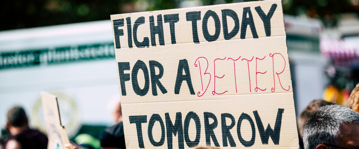 "Sign at a protest that reads ""Fight today for a better tomorrow"""
